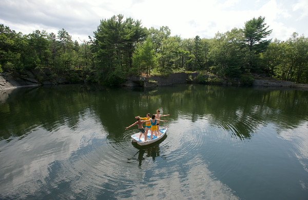 RYAN HUTTON/ Staff photo.<br /> Alexandra Berger, Edmund Sturgis, Jessica Cipriano and Timothy Ward balance in a row boat in Deep Pit Quarry during rehearsal for a performance sponsored by the Windhover Center for the Performing Arts this weekend.