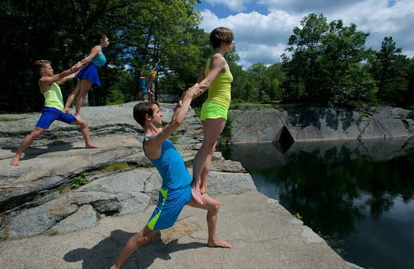 RYAN HUTTON/ Staff photo.<br /> From front to back, Sarah Slifer balances on the leg of Timothy Ward as Jessica Cipriano does the same with Edward Sturgis and Alexandra Berger does so with Samuel Swanton on the edge of the Deep Pit Quarry during rehearsal for a performance sponsored by the Windhover Center for the Performing Arts this weekend.