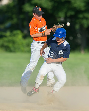 DESI SMITH/Staff photo.    Manchester/Essex's Matteo Cugno, is safe at seond base, as Beverly's Will Dooling can't make the play, Saturday afternoon at Cooney Field in Beverly.