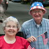 DESI SMITH/Staff photo. Sarah and Mike Mack of Manchester, show their independence, wearing matching hats and flags, as she watchers Manchester's 4th of July Parade  on School Street Friday morning. <br />   July 4,2014