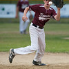 DESI SMITH/Staff photo.    Gloucester National's short stop Marcus Montagnino fieilds a ground ball hopper against M/E in a Little League game held at Boudreau Field Wednesday night.<br />   July 2,2014
