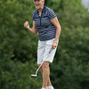 DESI SMITH/Staff photo. Beverly Rogers reacts as she sinks a putt during the 2014 Club Championship playoffs Sunday morning at Bass Rocks Golf Club.    July 20,2014