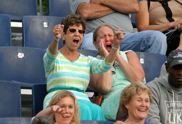 """MARIA UMINSKI/GLOUCESTER DAILY TIMES Marianne Felice and Valerie Ostrander, of the Worcester Tennis Club, do their """"John Isner"""" cheer during his match with the Boston Lobsters against Frank Dancevic of the Philadelphia Freedoms at the Manchester Athletic Club."""