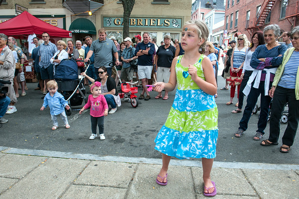 DESI SMITH/Staff photo.    Camdyn Conant 6, of Gloucester (right) dances to the music by Allen Estes and Will Hunt , and is joined by William Pinkham 15 months and Aaliyah Marschell 16 months old, during the Annual Main Street Block Party Saturday night.  July 19,2014