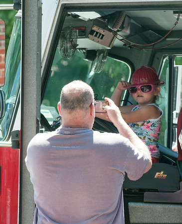 DESI SMITH/Staff photo.   Dan Shatford of Magnolia, takes a photo of his granddaughter Abby Rock 5, as she strikes a pose, while at the reopening and reception for the Magnolia fire station, Saturday morning.<br />   July 5,2014