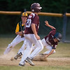 DESI SMITH/Staff photo.    A Gloucester National runner stummbles back to first as Manchester Essex's 1st basemen Allen Martin tags him for the out, in a Little League game held at Boudreau Field Wednesday night.<br />   July 2,2014