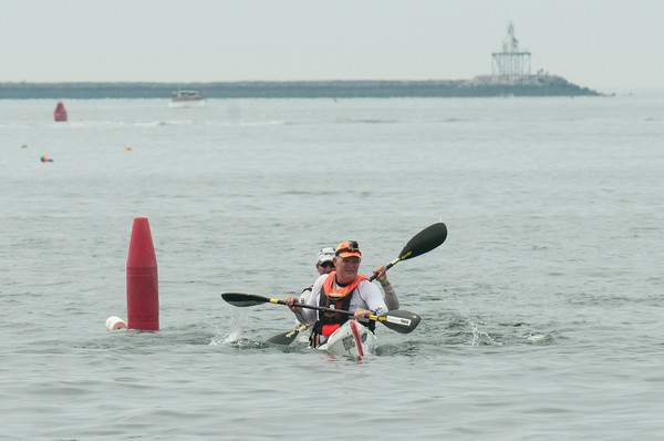 DESI SMITH/Staff photo.  12 time world champion olympian paddler, Oscar Chalupsky (front) of South Africa, and Joe Glickman, of Brooklyn, NY cross the finish first in the HPK Doubles at Pavilion Beach in the Blackburn Challenge, Saturday morning.    July 19,2014