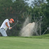 DESI SMITH/Staff photo.  Tyler Conigliari drives his shot out of the sand trap in the Bass Rocks Club Championship at Bass Rocks Sunday morning.   July 26,2014