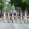 DESI SMITH/Staff photo.    Men dressed as revolutionary parade down School Street in Manchester's Fourth of July Parade Friday morning. <br />   July 4,2014