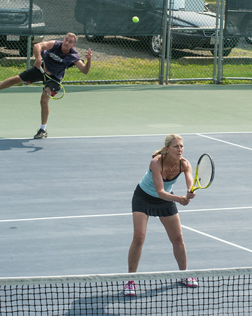 DESI SMITH/Staff photo. John Sperry serves in a doubles match with partner Nancy Gambal, against David Salah and Gloria Lust-Phillips, in the Bass Rocks Jerry Blitz Memorial Tennis Tournament held Saturday morning at Bass Rocks Tennis Courts.    July 26,2014