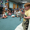 DESI SMITH/Staff photo. Grayson Quist 4, of Beverly, holds a 6 year old, 4 foot alligator during a live animal program by Richard Roth, of Creature Teachers from Litteton,MA Monday afternoon at the Sawyer Free Library .<br />   July 7,2014