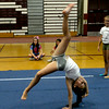 RYAN HUTTON/ Staff photo.<br /> Lauren Movalli, 11, looses control of a backflip at cheerleading camp in the Gloucester High School field house on Tuesday.