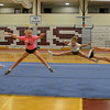 RYAN HUTTON/ Staff photo.<br /> From left, Avery Smith, 11, Alli Smith, 11, Kylie Jackson, 11, and Lauren Movalli, 11, practice their toe touch jumps at cheerleading camp in the Gloucester High School field house on Tuesday.