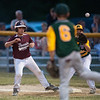 DESI SMITH/Staff photo.  Manchester Essex's pitcher Ian Talidero, throws back to first, keeping a Gloucester National runner on the bag, in a Little League game held at Boudreau Field Wednesday night.<br />   July 2,2014
