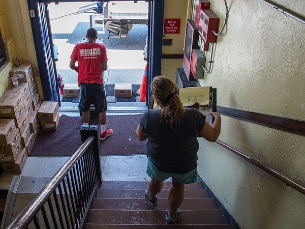 Desi Smith Photo.  West Parish principal Telena Imel removes some of her personal items from the St Ann's building that will be transferred to the new West Parish School Wednesday afternoon.     July 22,2016