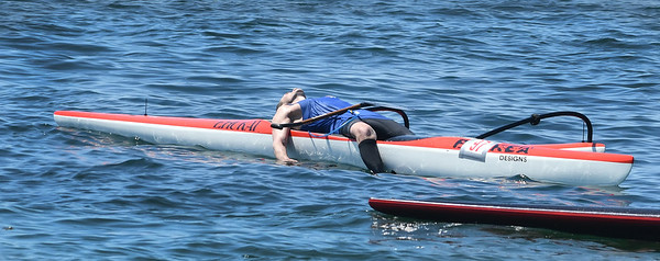 The solo rower in Outrigger #97 takes a break after crossing the finish line of the 2016 Blackburn Challenge.<br /> <br /> Photo by JoeBrownPhotos.com