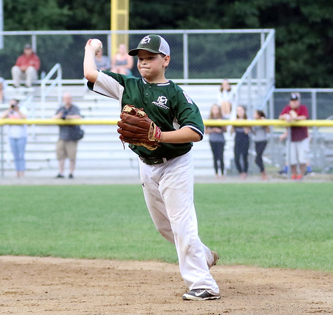 DAVID LE/Staff photo. Manchester-Essex second baseman Tripp Graves fires over to first to retire a Beverly batter in the District 15 Final on Thursday evening. 7/14/16.
