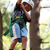 DAVID LE/Staff photo. O'Maley Middle School rising 6th grader Jason Earl tries to balance himself on a beam 27 feet in the air at Project Adventure on Friday afternoon. 7/22/16.