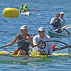 Lead by 2 person outrigger #83, a small pack of boats crosses the finish line of the 2016 Blackburn Challenge. <br /> <br /> Photo by JoeBrownPhotos.com