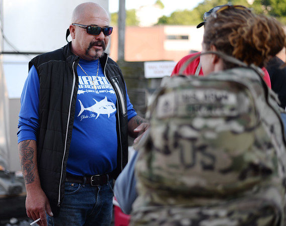 PAUL BILODEAU/Staff photo. Dave Marciano of Wicked Tuna greets veterans before ether head out to fish. Marciano and Tom Orrell of the Yankee Fleet  hosted a fishing trip to benefit the Wounded Warrior Project.