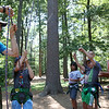 DAVID LE/Staff photo. Dillon Engelmann, left, the Youth and College Program coordinator at Project Adventure, teaches a bunch of O'Maley Middle Schoolers how to ensure a safe climb. 7/22/16.