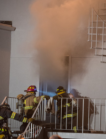Desi Smith Photo.  Heavy smoke pours out from a business complex at 239 Western Ave in Essex, as firefighters from surrounding towns fight a 2 alarm fire Monday night on the fourth of July.