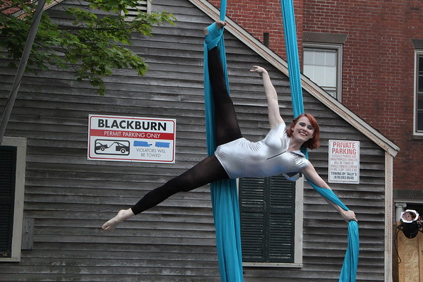 Vincenzo Dimino/Photo<br /> Jacqueline Judith of Circus Up performs during Gloucester's first downtown block party of the season Saturday.