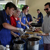 On left, Jake Edwards, Katherine Keith and Sam Stubs serve breakfast to Manchester residents.<br /> <br /> Vincenzo Dimino/Photo