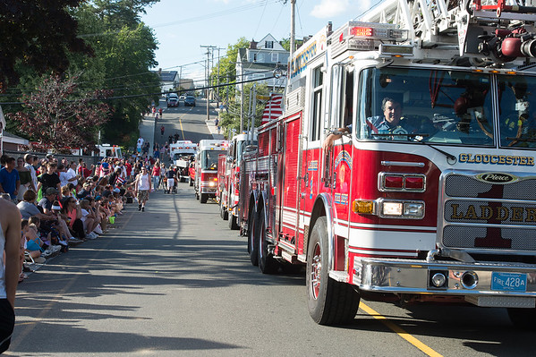 Desi Smith Photo.    Spectators line both sides of Centenial Ave as Gloucester Fire lead the way as they head out onto the parade route from Gloucester High School in the Fishtown Horribles Parade Sunday afternoon.     July 3,2016