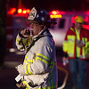 Desi Smith Photo.     Gloucester Deputy Chief Miles Schi works a 4 alarm at business complex located at 239 Western Ave in Essex,Monday night on the fourth of July.