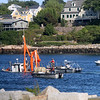 """Allegra Boverman photo<br /> Marine salvagers work to float the sunken Irish Piper in the southeast section of Gloucester Harbor on Saturday. The boat has checkered history, included an """"arrest"""" in 2015 for the owners' nonpayment of debts."""