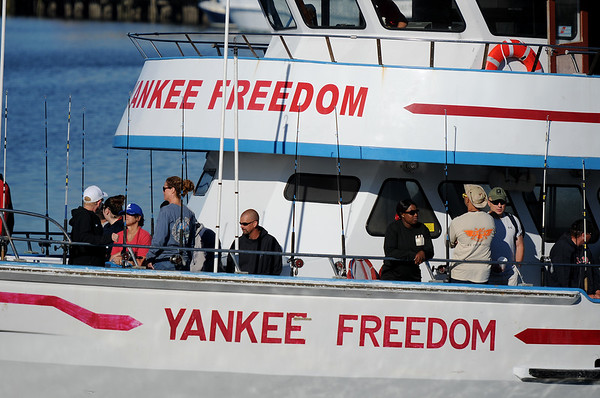 PAUL BILODEAU/Staff photo.Veterans and their families head out on the Yankee Freedom from the bak side of the State Fish Pier.  Dave Marciano of Wicked Tuna and Tom Orrell of the Yankee Fleet  hosted a fishing trip to benefit the Wounded Warrior Project.