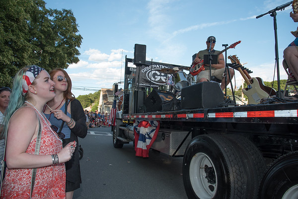 Desi Smith Photo.     Emily Ackerman left,and Katie Stratton right, both of Gloucester, dance to the music of the band Generation Gap as they pass by onto the parade route from Gloucester High School in the Fishtown Horribles Parade Sunday afternoon.     July 3,2016