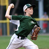 DAVID LE/Staff photo. Manchester-Essex starting pitcher Peter Martin fires a pitch against Beverly in the District 15 Final on Thursday evening. 7/14/16.