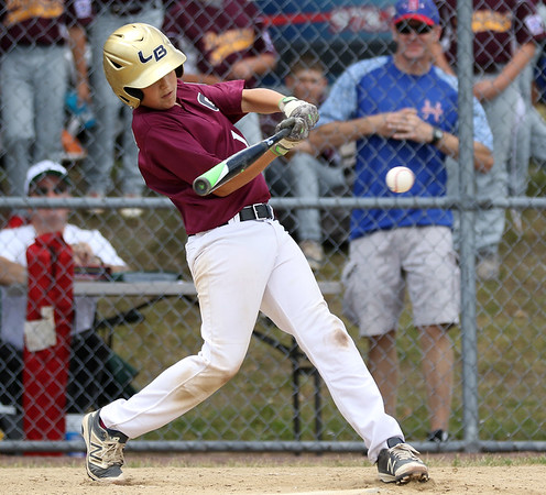 DAVID LE/Staff photo. Gloucester's Zach Oliver lines a hit against Masco on Saturday morning. 7/2/16.