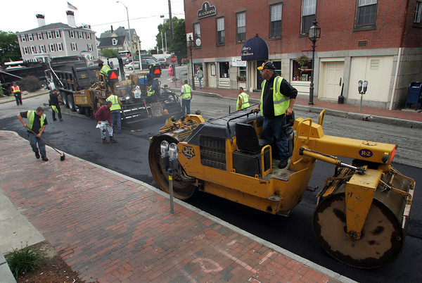 Gloucester: Crews work at completing the paving of Main Street Thursday morning. Mary Muckenhoupt/Gloucester Daily Times