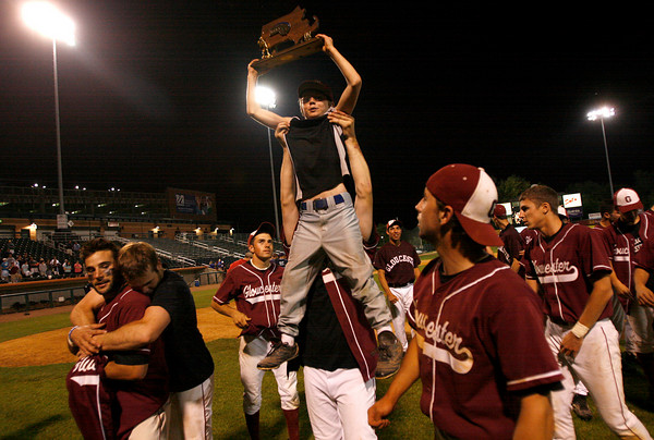 "Lowell: Aaron ""Squirrel Boy"" Smith is hoisted up with the Division I North Championship trophy after the Gloucester Fishermen defeated St. John's Prep 8-7 at LeLacheur Park in Lowell on Saturday night. Photo by Kate Glass/Gloucester Daily Times Saturday, June 6, 2009"