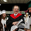 Manchester: John Chiffer, a physics teacher at Manchester Essex Regional High School, died unexpectedly Novemeber 24.  Here he is seen last spring signing a student's yearbook at gradutation.  Mary Muckenhoupt/Gloucester Dily Times