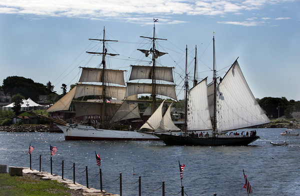 Gloucester: The Thomas E. Lannon, right, sails up next to the Picton Castle as the Tall Ship heads into Gloucester Harbor for the first Sail Gloucester Festival Saturday morning. Mary Muckenhoupt/Gloucester Daily Times