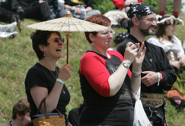 Gloucester: From left, Lillian Santangelo, Diana Koulalis and Bob Wildes laugh at a comedy show put on by pirates at the annual New England Pirate Faire at Stage Fort Park Saturday afternoon. The festival included a variety of events including musicians, interactive plays, puppeteers, magicians and a Tortuga marketplace Mary Muckenhoupt/Gloucester Daily Times