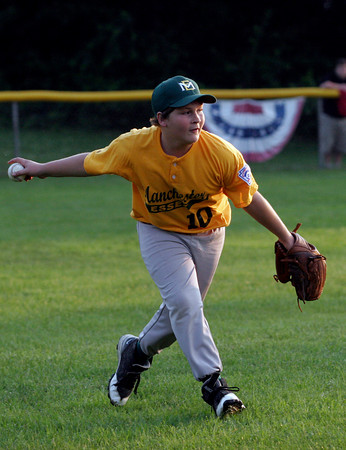 Manchester Essex's Will Burgess fields a ball during their District 15 Little League All-Star Tournament game against Peabody West at Stage Fort Park last night. Photo by Kate Glass/Gloucester Daily Times Monday, June 29, 2009