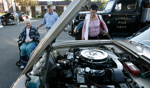 Gloucester: Billy Natti, left, Carl Natti and Flossie LeMaster look at a 1963 Studebaker at the Golden Living Center's Antique Car Show on Tuesday night. In addition to the cars, residents and car owners also enjoyed a barbecue. Photo by Kate Glass/Gloucester Daily Times Tuesday, June 16, 2009