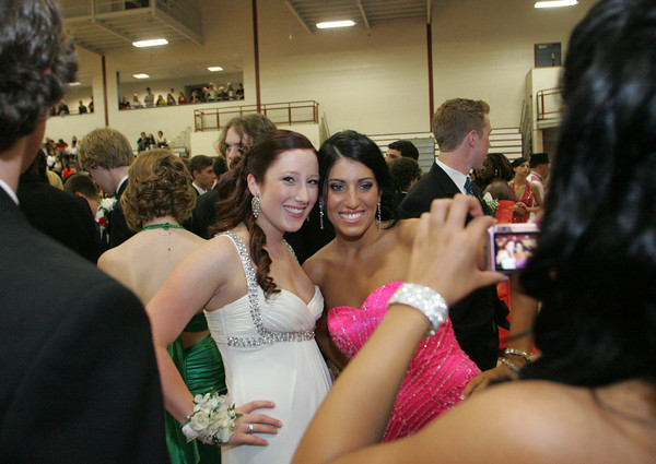Gloucester: Mikayla Gentile and Lindsey Rogers pose for a picture taken by Elise Orlando during the promenade held before the Gloucester High School senior prom Friday evening. Mary Muckenhoupt/Gloucester Daily Times