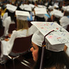 Gloucester: Abi Geraghty wears her cap signed by family and friends at GHS Graduation Exercise held inside at the Benjamin Smith Feild House Sunday afternoon.   Desi Smith Photo/ Gloucester Daily Times.June 14,2009