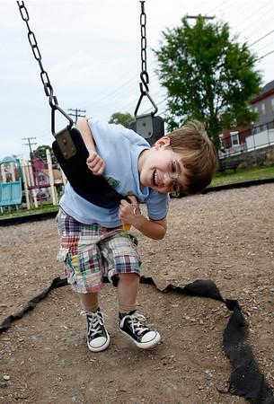 Gloucester: Zachary Alfano of Gloucester, who turns 5 today, spins around on the swings at the Benjamin Smith Playground yesterday morning before heading off to school. Photo by Kate Glass/Gloucester Daily Times Tuesday, June 2, 2009