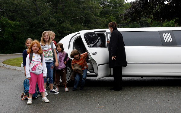 Gloucester: Plum Cove Elementary School students (from left) Rose Trotman, Cate Delaney, Ava Trotman, Ollie Emerson, Ella Marshall, and Silas Emerson arrived at the last day of school in style yesterday. The students had won a limo ride from A Whitehorse Limousine through the school's holiday auction. Photo by Kate Glass/Gloucester Daily Times Monday, June 22, 2009