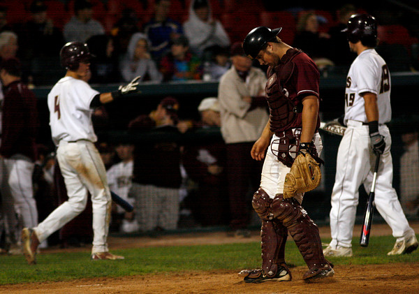 Brockton: Gloucester catcher Brett Cahill hangs his head as BC High scores a run in the 6th inning of their 8-3 loss to BC High in the State Semi-Finals at Campanelli Stadium in Brockton last night. Photo by Kate Glass/Gloucester Daily Times Wednesday, June 10, 2009