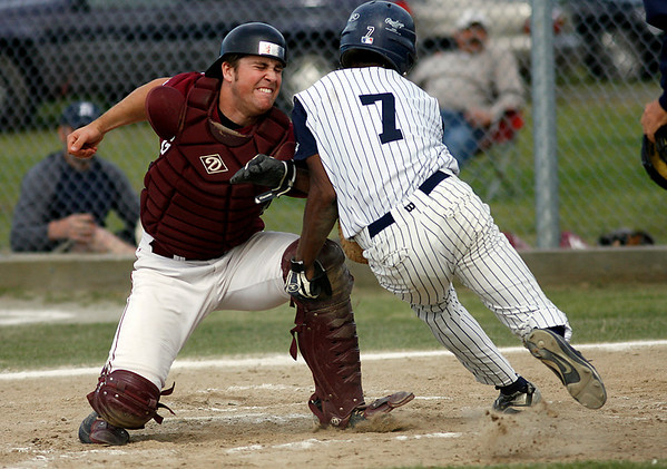 Gloucester: Gloucester's Brett Cahill gets Lawrence's Juan Ventura out at the plate in the second inning of the second round of the North Division I tournament yesterday. Photo by Kate Glass/Gloucester Daily Times Monday, June 1, 2009