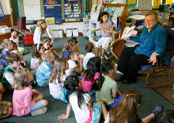 """Gloucester: Mayor Carolyn Kirk and her daughter, Baylee, read """"Which Puppy?"""" by Kate Feiffer to first graders at East Gloucester Elementary School yesterday afternoon as part of the First R program. Photo by Kate Glass/Gloucester Daily Times Wednesday, June 3, 2009"""