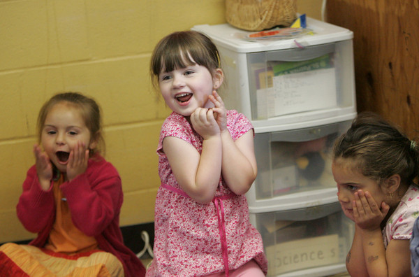 Gloucester: Emily Kane sings a silly song with her classmates for the friends and family who came to pre-school graduation ceremonies in Cristina Thomas's classroom at the Fuller School Thursday afternoon. Also pictured is Daunika Billante, left, and Hannah Fletcher. Mary Muckenhoupt/Gloucester Daily Times